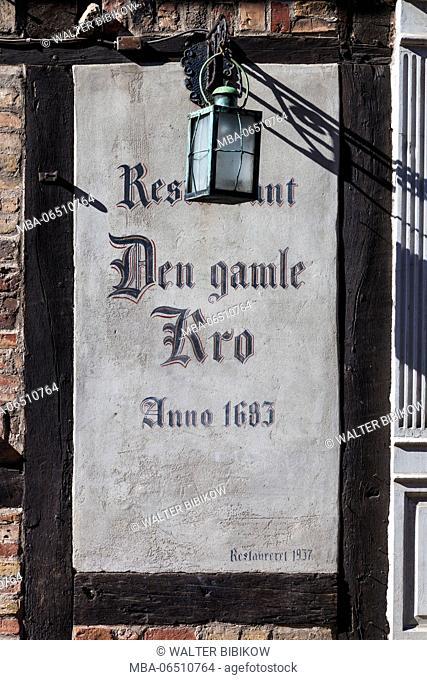 Denmark, Funen, Odense, sign for Den Gamle Kro Restaurant, started in 1683