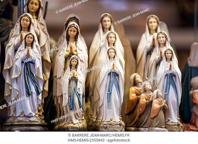France, Hautes Pyrenees, Lourdes, statuette of the Virgin in the window of a religious store