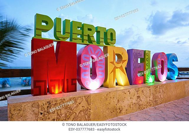Puerto Morelos word sign in sunset Mayan Riviera Maya of Mexico