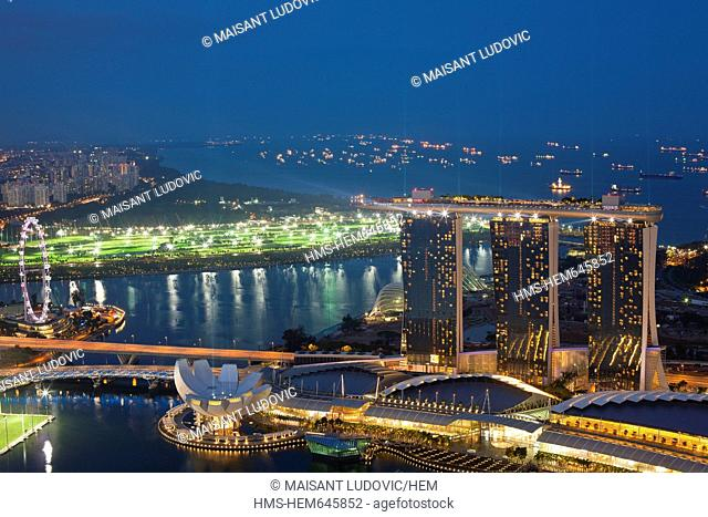 Singapore, Marina Bay, view from the 1-Altitude bar over the Marina Bay Sands Hotel, opened in 2010, and designed by architect Moshe Safdie for 4