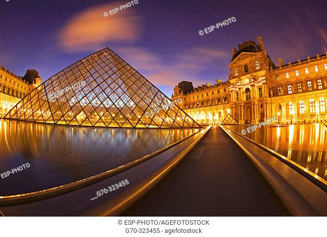 Louvre palace and museum at night. Paris, France