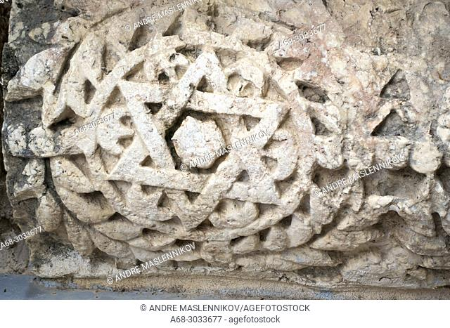 Close up detail of the Star of David carved in stone Parts of the synagogue stones are displayed in the area around the excavations