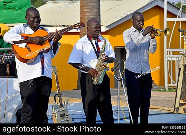 South Sudanese musicians who accompany the regionally known Ugandan musician Mukisa John Mary during his performance, recorded on December 7th, 2019