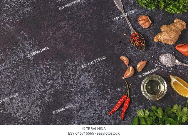 Background with spices, herbs and olive oil, top view, copy space