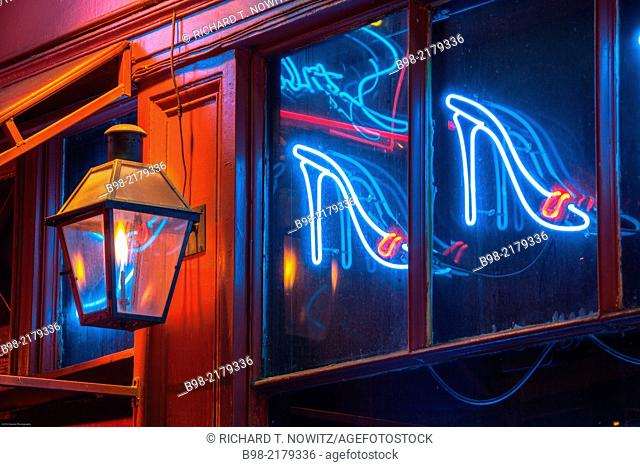 Gas lights and Neon lights illuminate Bourbon Street in New Orleans' French Quarter