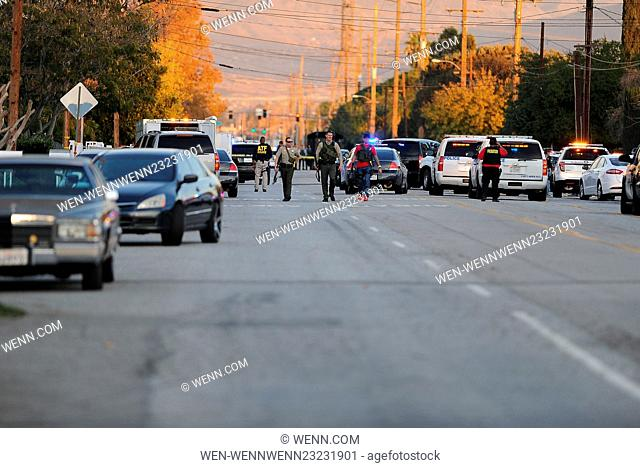 Law Enforcement Officers cordoned off multiple blocks of San Bernardino Ave between Mountain View and Richardson where one male and one female shooting suspects...