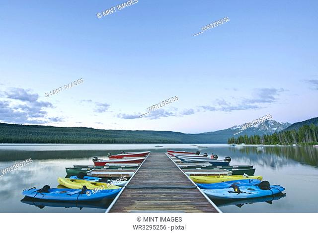 Canoes Docked on a Lake