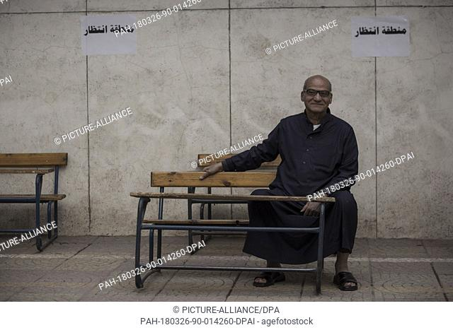A man sits on a waiting area before casting his vote on the first day of the 2018 Egyptian presidential elections, at a polling station, in Cairo, Egypt