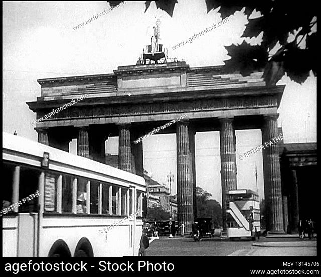 Buses Driving Down a Road with the Brandenburg Gate in the Background in Berlin, Germany - Germany
