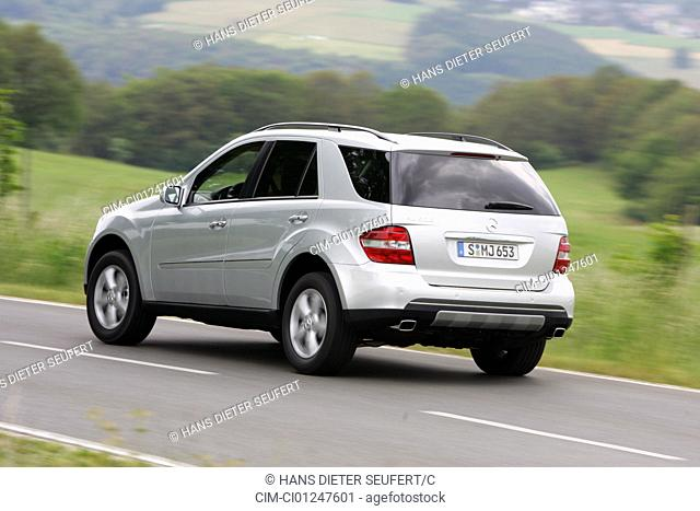 Car, Mercedes ML 500, silver, model year 2005-, driving, diagonal from the back, rear view, country road