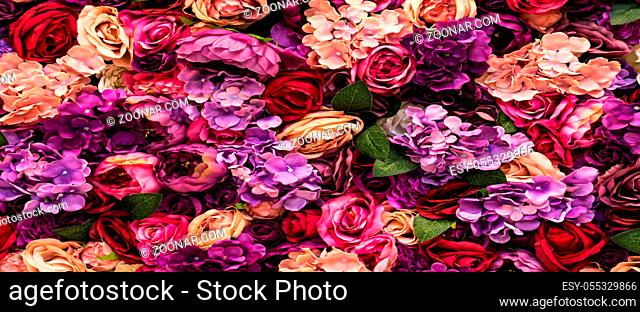 Many different pink flowers background texture, romantic blurred design beauty purple roses