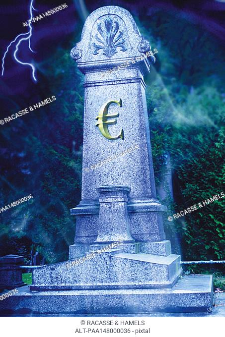 Euro sign on a grave stone