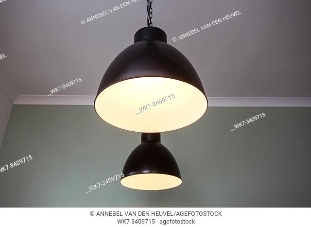 Ceiling light closeup, hanging from the ceiling modern design. home decoration clean
