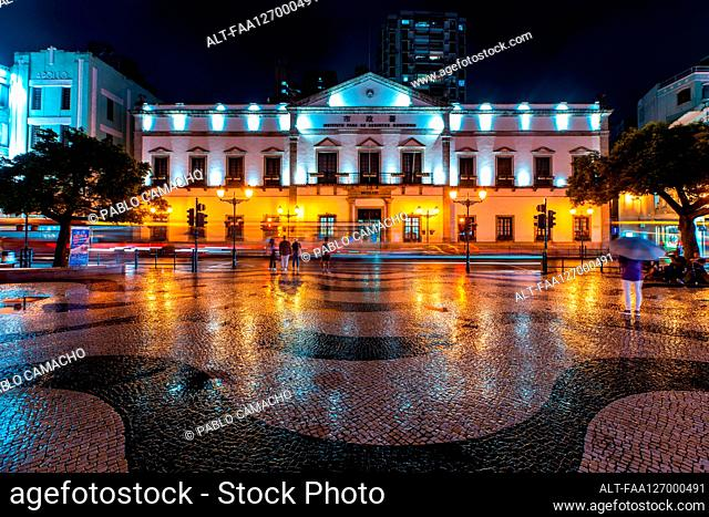 Traffic moving in front of government building at night, Macao
