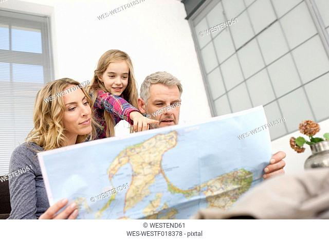 Germany, Leipzig, Family looking at map