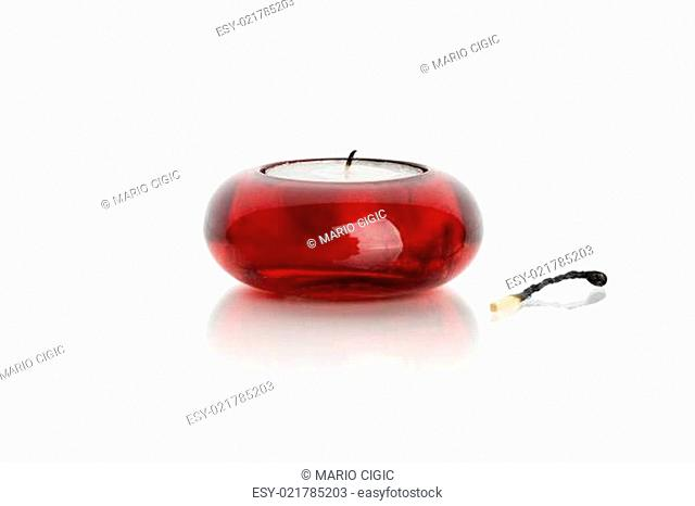 match and candle on white