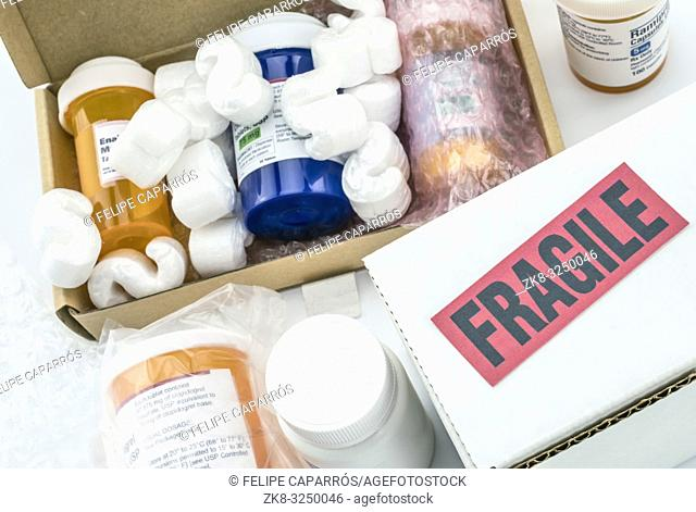 Several bottles of medication in boxes, conceptual image