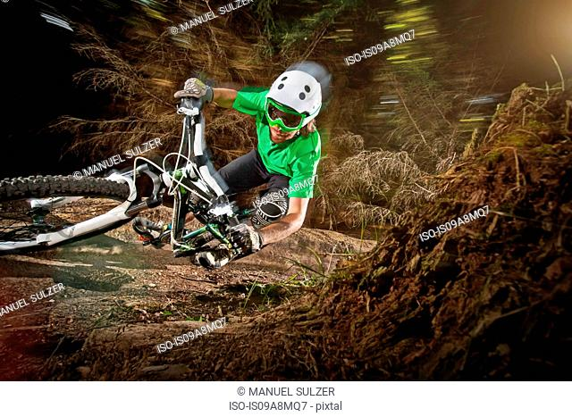Mountain biker riding narrow track