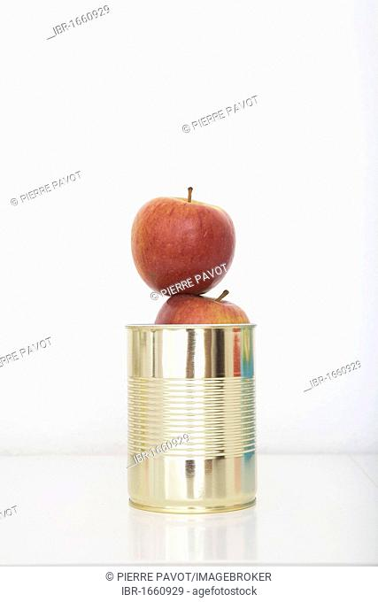 Fresh apples in a tin can, preserved food