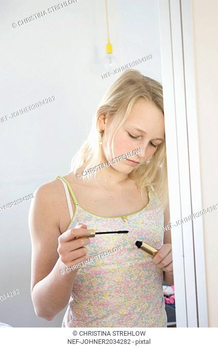 Girl holding mascara