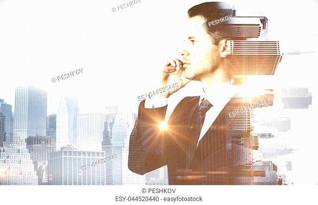 Side portrait of handsome man talking on phone. Abstract city background. Communication concept
