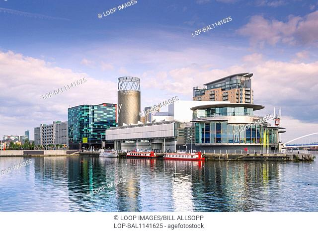 Salford Quays theatre seen across the north bay of the basin