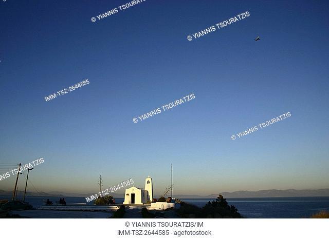 Plane flying over Church Agios Nikolaos near the port of Rafina, located on the eastern coast of Attica, Greece, Europe