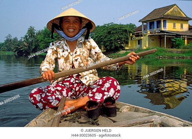 VMN Vietnam Hoi An woman in a boot on canal