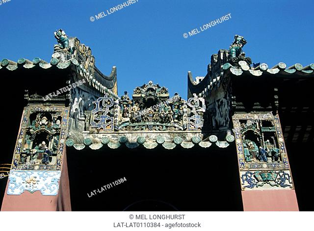 Kun Iam temple. Dedicated to Goddess of Mercy. Shrine. Roof detail. Ornate statues,ceramic figures on facade