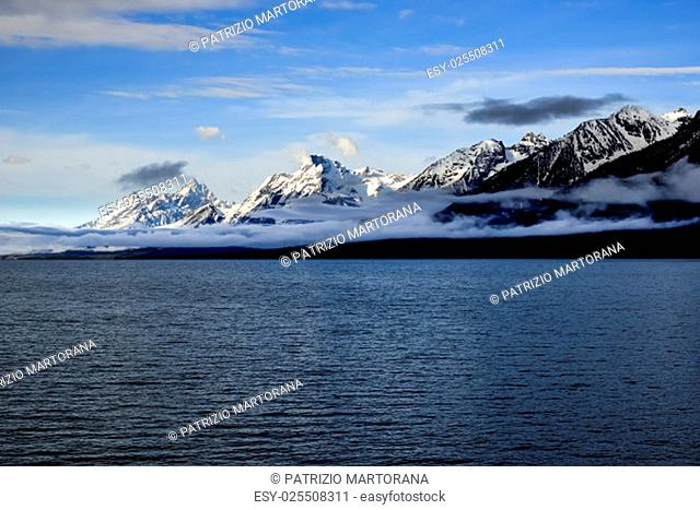 A view of the towering snowcapped peaks of the Grand Tetons in Grand Teton National Park, near Jackson Hole. Jakson Lake