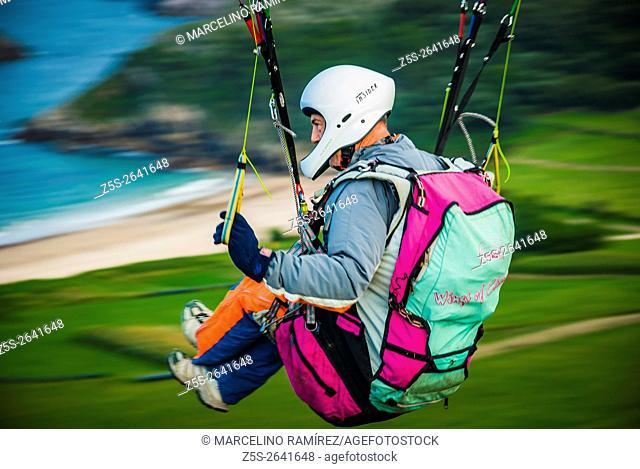 Paraglider pilot flying. Niembro, LLanes, Asturias, Spain