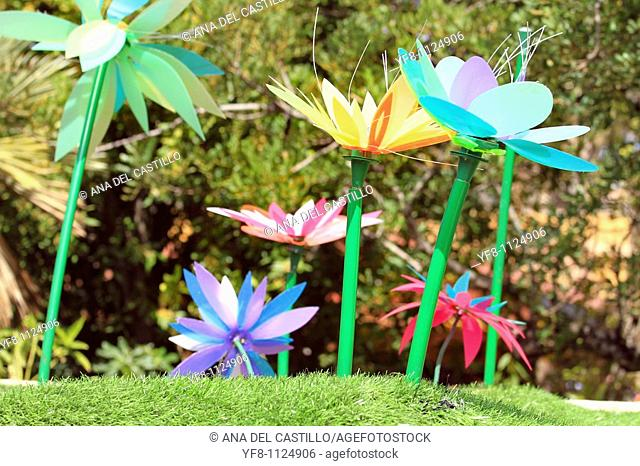 Tropical garden with plastic flowers