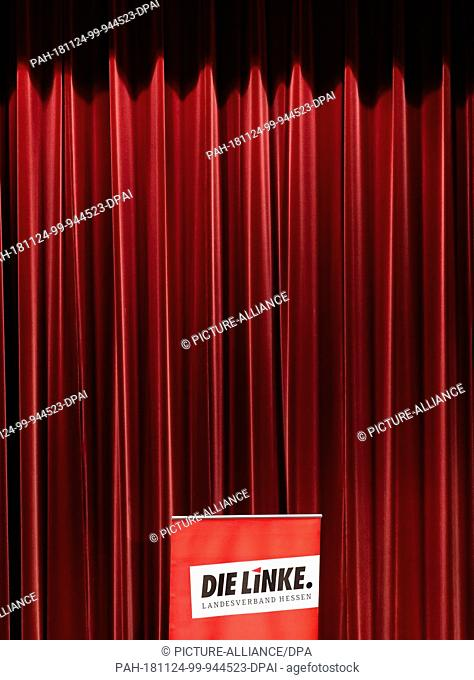 24 November 2018, Hessen, Gießen: A display with the logo of the Left Party will stand in front of a curtain on the stage of the Congress Hall during the state...