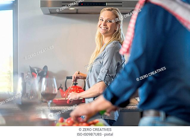 Man and woman in kitchen, preparing food