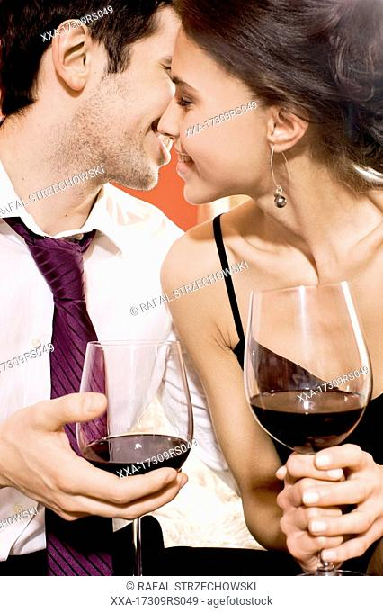 happy couple drinking red wine