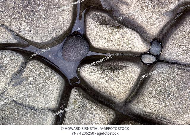 Beach rocks weathered into an abstract pattern