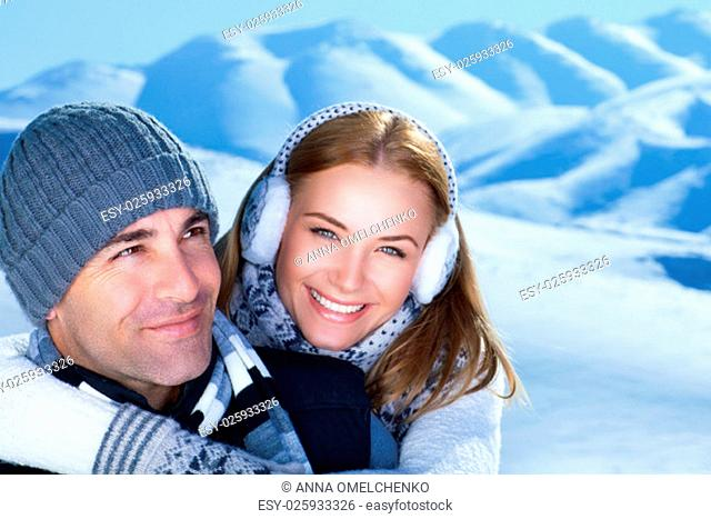 Closeup portrait of cheerful smiling couple in the winter park, having fun in the mountains, happy wintertime holidays