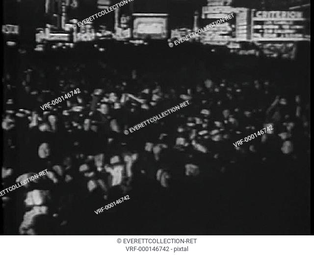 Crowd celebrating on New Year's Eve, 1930s
