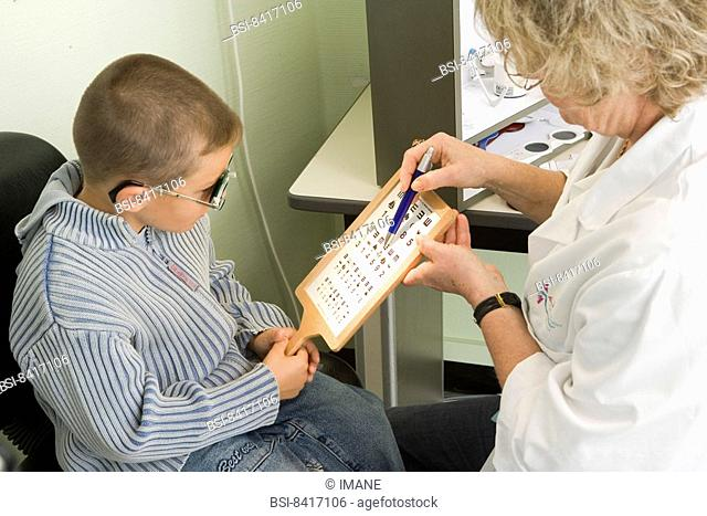 OPHTHALMOLOGY, CHILD Photo essay at the hospital of Meaux 77, France. Department of ophtalmology. Test of visual acuity from near with a Parinaud ladder and...