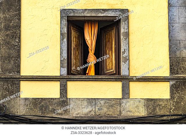 Window with knotted curtain in Las Palmas de Gran Canaria, Canary Islands