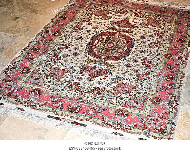 hand made persian carpet on marble floor
