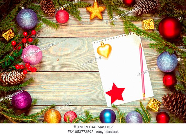Christmas tree with decoration on a wooden board. Christmas toy. New year. Sheet for congratulations