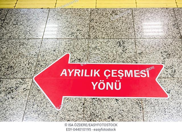 Signboard on the ground shows direction of Ayrilik Cesmesi train station stop,Istanbul,Turkey