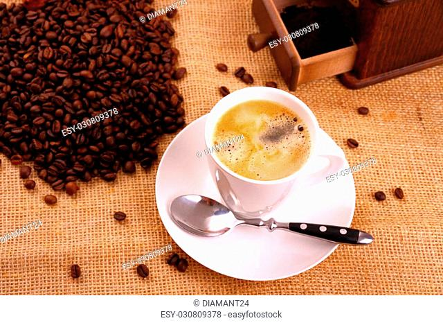 Coffee in white cup and coffee mill, horizontal