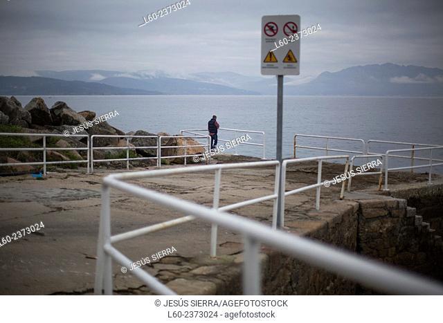Lonely man in Finisterre. Costa da Morte. Galicia. Spain