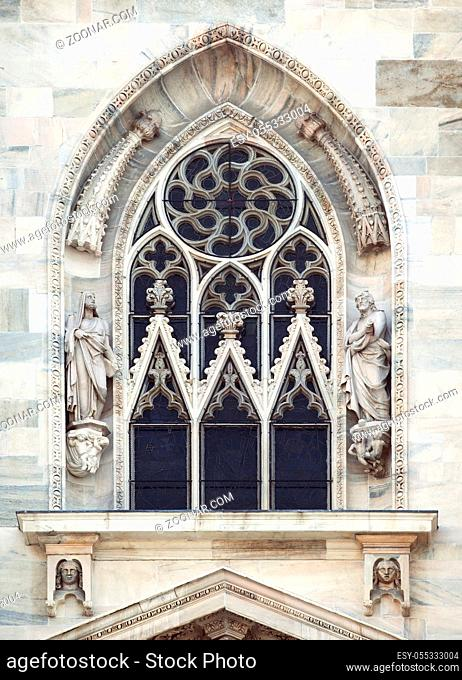 Ornamented window of a cathedral in gothic style