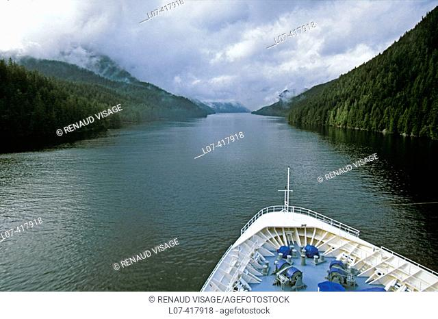 Cruise boat in narrow channel. Inside Passage. Alaska. United States