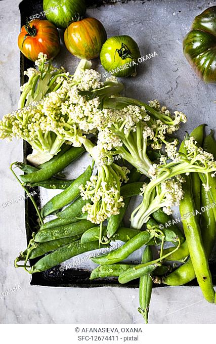 Fresh green vegetables for baking on a stove sheet