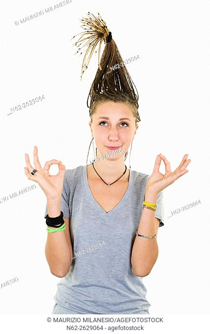 Blonde girl with funny expression doing yoga with pigtails raised vertically on her head