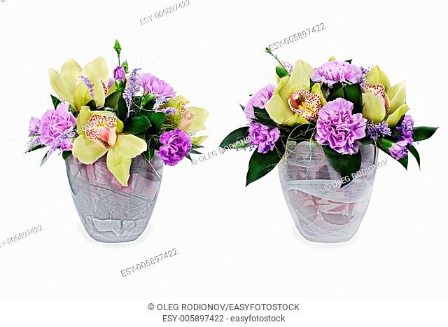 colorful floral bouquet of roses,cloves and orchids arrangement centerpiece in glass vase isolated on white background